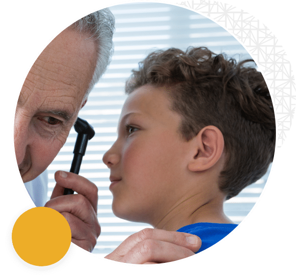 Caring ear doctor helping a patient at ENT and Audiology Associates in the Triangle NC